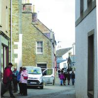 View of the A965 in Stromness, paved with stone flags and granite setts